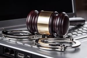bigstock-handcuffs-and-judge-gavel-on-c-45589036